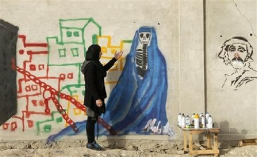 "muslimwomeninhistory:  An Afghan artist Malina Suliman paints graffiti on a wall in Kandahar city. For Afghanistan, the only thing out of place in this gruesome scene is that the blood is not real, but is red paint. (Reuters) Afghan female artist beats the odds to invigorate Kandahar's art scene Charred bodies lie scattered against blood-stained walls and debris covers the ground. The unusual thing in this gruesome scene is that the ""blood"" is red paint, and part of an art installation. It's a work by 23-year-old Afghan artist Malina Suliman. She risks her life, Suliman says, sometimes working by flashlight after dark, to create art in southern Kandahar province, still one of the most dangerous areas in the country.Her pieces, which range from conceptual art to paintings and sculpture, are bold representations of the problems facing her generation.""Many people had never seen an art installation,"" Suliman said of ""War and Chaos,"" her exhibit last year, which depicts the aftermath of a suicide bombing, a not uncommon event in Kandahar.""Some were offended and others were hurt because they'd experienced it before.""Her pieces earned her an invitation last year to visit the Kabul palace of President Hamid Karzai, who is also from Kandahar, where she showed him her art.Suliman's work is now making waves in the Afghan capital, where she lived as a child after fleeing the violence of her native province. She had two Kabul exhibitions in December, a highlight of which was a sculpture of a woman in baggy clothing with a noose tied around her neck."