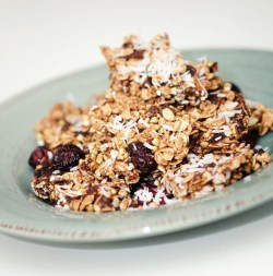 Raw chocolate granola bars with sea salt and cacao I've never liked shop-bought granola. It's too crunchy. Or not crunchy enough. And it always has pesky shards of coconut hiding amongst the over-dried raisins that gets stuck inbetween teeth, leading to a bitter battle with the tongue. And it all seems to be sweetened - sometimes sickenly so - with plain old sugar. Perhaps I'm just persnickety. Regardless, once you make your own granola and granola bars, I think it's likely you'll forget there was ever a moment of doubt. The best part is that the precise ingredients have little baring on the end result (deliciousness). I personally love to make raw granola because inhaling it at the speed of light is less guilt-ridden. I love throw cacao powder in because as much as I protest that I don't like chocolate, I really secretly do. I also love to add buckwheat for some serious crunch in comparison to the chewy cranberries. And I love the occasional  Okay, I have to stop now before the craving get too much and I'm making granola till 2:00am. My point being: You can use your favourite nuts, your favourite seeds, honey instead of agave syrup, raisins instead of cranberries. You could throw in chia seeds if you're looking for protein, or replace raw cacao with maple syrup. Or go totally crazy and add peanut butter. Why the hell not. Make it your own. But just in case you like the look of mine, here's how I do it Two handfuls dried cranberries One handful raw almonds One handful raw cashew nuts A handful of buckwheat Four handfuls of raw oats A tablespoon of cacao Two tablespoons of agave syrup One teaspoon of sea salt A teensy splash of olive oil Optional: Coconut flakes to serve Place the cranberries in a food processor or blender till they're roughly chopped. Add the nuts and blend again until the nuts are roughly quartered in size. Careful not to over-blend, else you'll end up with dust. Pop the mixture into a large bowl and add the buckwheat, cacao, agave syrup and sea salt. Mix vigourously. You can add a tiny splash of oil to help mix the cacao. When the ingredients are equally coated, add the oats and shake together. Place the granola in a oven dish and spread evenly. Cover in foil and place pressure (I used a book) to compact it. Keep it in the freezer until serving. Immediately out of the freezer, you can chop it into bars. Soon after, it will soften and you'll have granola. Also the coolness makes it a more refreshing bite.