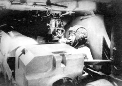 The interior of a Soviet SU-152, a self-propelled heavy howitzer. The vehicle's commander can be seen in the background