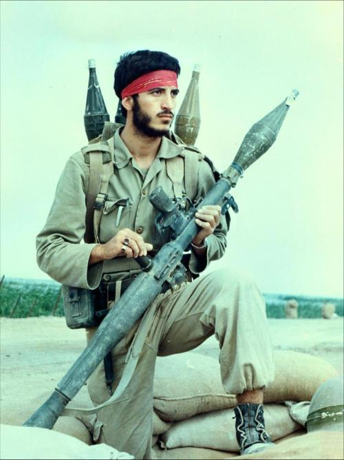 An Iranian soldier poses with his RPG on top of a bunker, during the Iran-Iraq War (Circa 1980's)