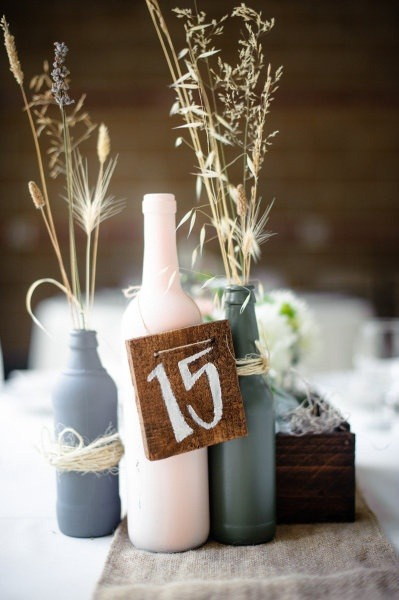 wooden table numbers with glass bottles