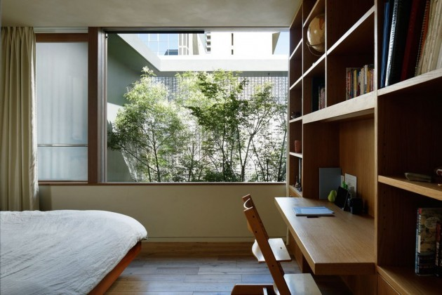 Bedroom workspace featured in a glass house in Hiroshima, Japan.