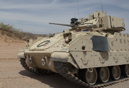 An opposition force M2 Bradley infantry fighting vehicle with the 123rd Brigade Support Battalion, prepares to engage 1st Battalion, 6th Infantry Regiment vehicles during a simulated battle at Network Integration Exercise 13.2 near Dona Ana, N.M., May 7, 2013. (U.S. Army photo by Sgt. Todd Robinson/Released)