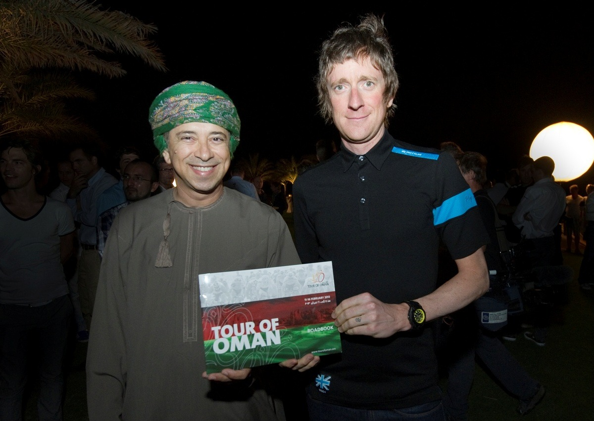 inrng:  Sultan Hamdoon Al Harthi and Bradley Wiggins with the Tour of Oman Road Book. Photo: Muscat Municpality  could there be a more goofy looking fellow?   yes.