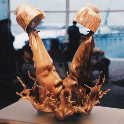 """langste:  These """"coffee kiss"""" sculptures are part of an ongoing series by Chinese artistJohnson Tsang. Started in 2002, the series is named after a local drink called Yuanyang, which is made using a mixture of three parts coffee and seven parts Hong Kong-style milk tea to perfectly represent both Eastern and Western cultures."""