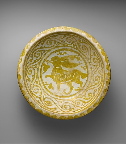 Bowl Depicting a Running Hare Object Name: Bowl Date: first quarter 11th century Geography: Egypt Medium: Earthenware; luster-painted on opaque white glaze.