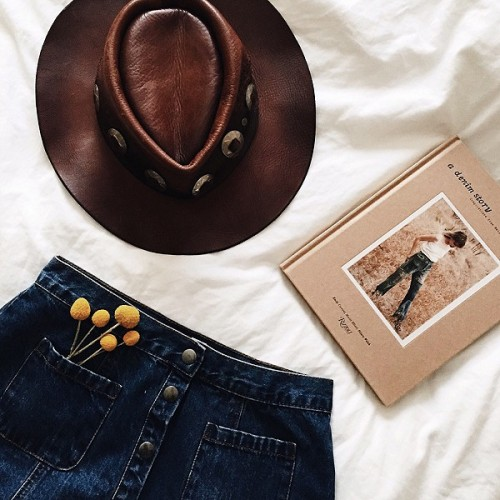 free people freepeople jean skirt denim skirt button up skirt leather hat cowgirl hat book reading fashion style bedroom inspo flat lay flowers daisys ootd