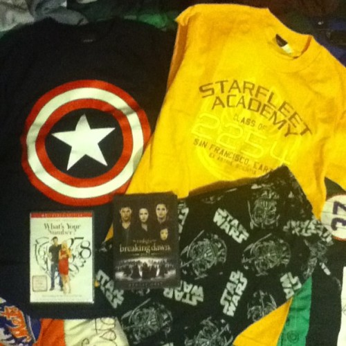 My birthday gifts: #CaptainAmerica tee, #StarTrek tee, fleece #StarWars #DarthVader pj pants, #WhatsYourNumber, and #Twilight #BreakingDawnPartII. Not pictured: #LoverAtLast (not arrived yet) and Captain America poster. Basically I am a nerd and I have awesome parents 😁