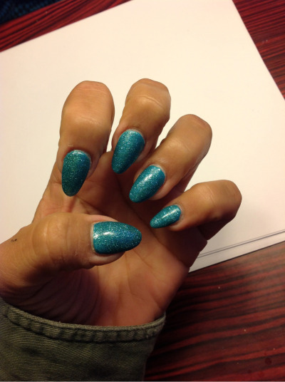 These were my nails about a week ago…. Just a teal nail color with teal glitter…. I need to buy a hd camera so you guys can fully enjoy the color :)