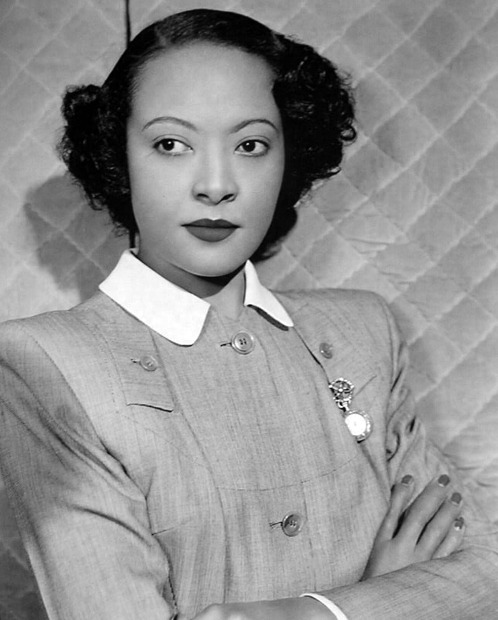 "Actress Theresa Harris as she appeared in the 1948 film, ""The Velvet Touch,"" which starred Rosalind Russell. Ms. Harris was the inspiration behind Lynn Nottage's play, ""By the Way, Meet Vera Stark"" which starred Sanaa Lathan. From Donald Bogle's Bright Boulevards, Bold Dreams: The Story of Black Hollywood: ""Harris - who was both outspoken and highly intelligent - didn't mince words about the plight of colored actresses. She told Fay M. Jackson, of the California Eagle in August 1937: ""I never felt the chance to rise above the role of maid in Hollywood movies. My color was against me. The fact that I was not 'hot' stamped me as either an uppity 'Negress' or relegated me to the eternal role of stooge or servant. I can sing but so can hundreds of other girls. My ambitions are to be an actress. Hollywood had no parts for me."" Photo via A Certain Cinema."