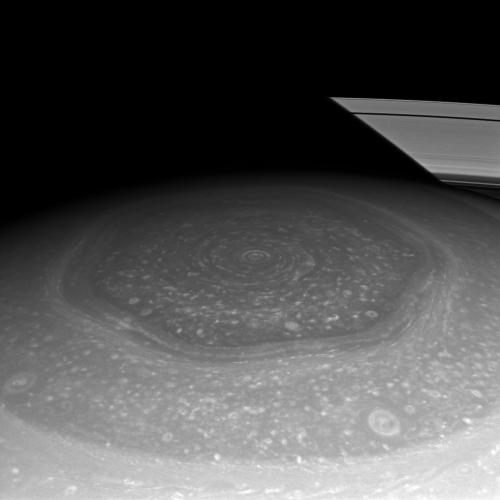 (via APOD: 2013 February 20) Saturn's Hexagon and Rings Image Credit: NASA/JPL-Caltech/Space Science Institute (Cassini spacecraft) Nobody's really sure why Saturn's north pole has this very stable hexagonal structure in the clouds. Add to that beautiful mystery the image of the shadow cast across the ring structure in the background. And, to top it all off (rimshot!), the polar clouds, the small circular bit right at the center of of everything, have this crazy look:  Click the image or here to see the full size of the vortex: http://apod.nasa.gov/apod/ap121204.html That hexagon has been there since Voyager flew by, and Cassini was capturing images of it in infrared before the Sun rose on the pole. Amazing!