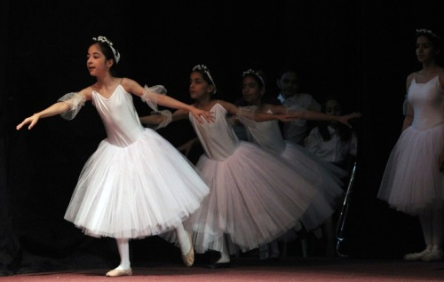 mideastcuts:  Iraqi dancers from a ballet and music school perform at al-Ribat Hall in Baghdad during an annual production marking the end of the school year, on April 25, 2013. Photo by Ahmad al-Rubaye / AFP