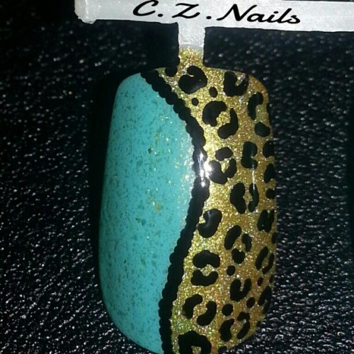 A close up of the nail :) #nailartwow #nailartswag #nailjunkie #nailartjunkie #nailpolish #nailart #love #leopardprint #leopard #glitter #gold #holographic #pretty #handpaintednailart #nails2inspire #czcustomnails #instapic #instanails #nailstagram #bigcartel #nails2inspire www.cznails.bigcartel.com