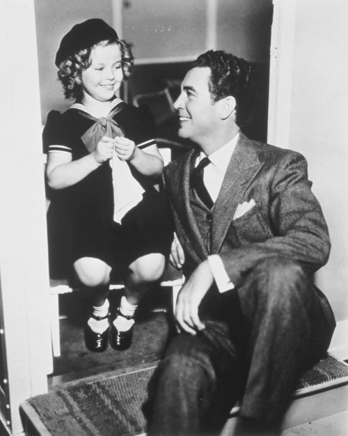 Shirley Temple and Michael Whalen behind the scenes of Poor Little Rich Girl, 1936.