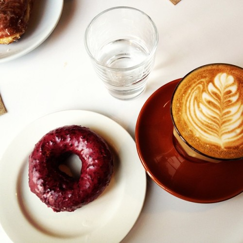 hungryeditor:  Settled on a blueberry @doughnutplant & a flat white. #latergram (at Bowery Coffee)