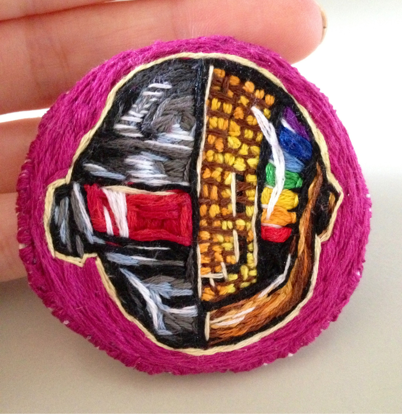 Been getting back into stitching little pins again, fun stuff! Here's a Daft Punk one I made for a friend :)