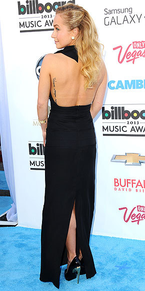 Better From The Back? Hayden Panettiere at the Billboard Music Awards In what might be the most demure neckline Las Vegas has ever seen, Hayden opts for sophisticated over sexy with a tiered black gown and pretty side-swept waves.