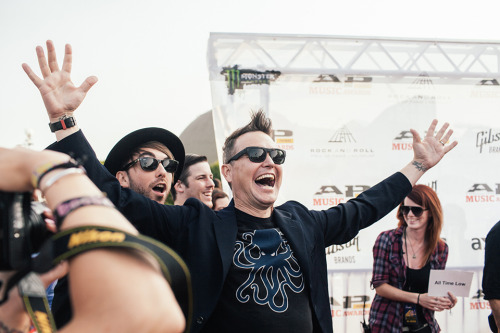 Mark Hoppus photobombing Alex Gaskarth at the APMAS  APMAS red carpet photo gallery on idobi.com
