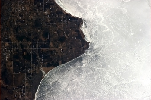 colchrishadfield:  The yin and yang of ice and land at Lake of the Woods.