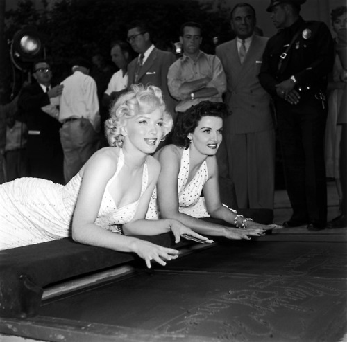 thebeautyofmarilyn:  Marilyn and Jane at Graumen's Chinese Theater, 1954.
