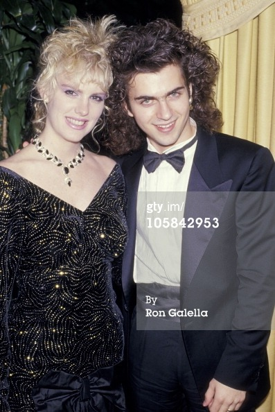 "Dweezil Zappa & Katie Wagner, 1987 ""Dweezil Zappa is so young that the last woman he dated, model Katie Wagner, was also briefly his legal guardian while they were going out. He was a minor, she was over 21, and he needed someone to take legal responsibility for him while he was filming a small part in an Arnold Schwarzenegger movie. She agreed to help out, but who could blame her if she felt less like the woman who was going to bed with him than the woman who was tucking him in? Katie, 23, the daughter of actor Robert Wagner, recalls saying to him, ""Trying to make me feel old, Dweez?"""" (People)"