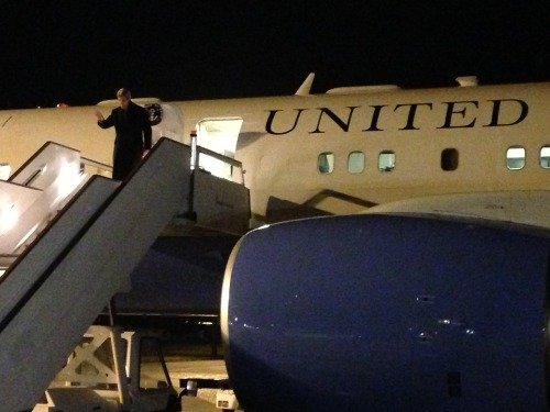 U.S. Secretary of State John Kerry waves as he exits U.S. Air Force Boeing 757 upon arrival to London, United Kingdom, February 24, 2013, during his inaugural overseas trip as Secretary of State. [State Department photo/ Public Domain]