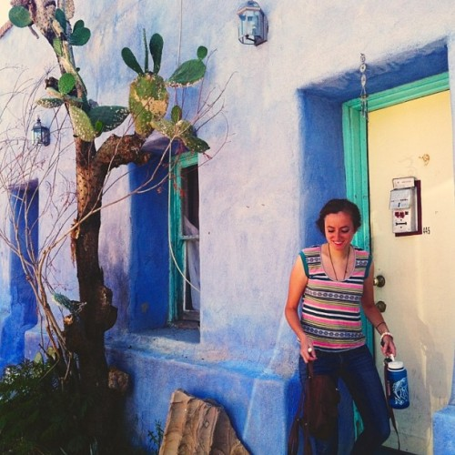 Cactus, blue adobe, and Rebecca Cohen — so picturesque