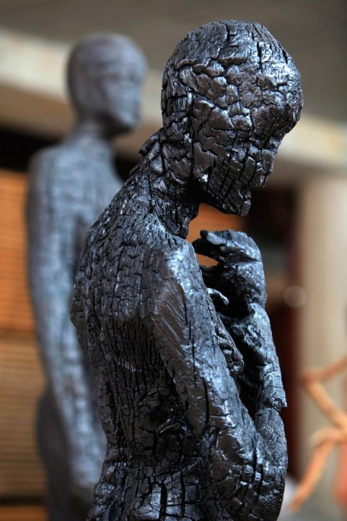 WOOD SCULPTURES BY ARON DEMETZ For years, Aron Demetz (facebook) has been focusing on the human figure, on contemporary characters which appear to be frozen in poses of the antique portraiture or paralysed in bizarre postures. Aron uses traditional woodcarving techniques to convey his preoccupation with humanity's relationship to nature. In his work he eschews the classical opposition of human and nature, and allows the two to become an inseparable whole, evoking the primordial experience.