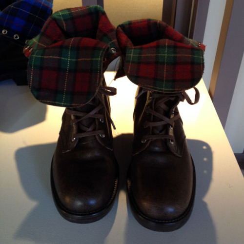 Grunge-chic flannel-lined boots at the Chanel Metiers d'Art preview. Photographed by Julia Rubin.