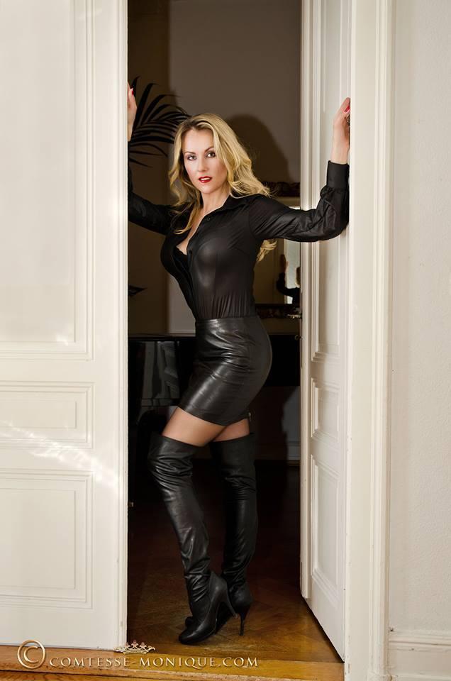 Slut in tight leather mini skirt