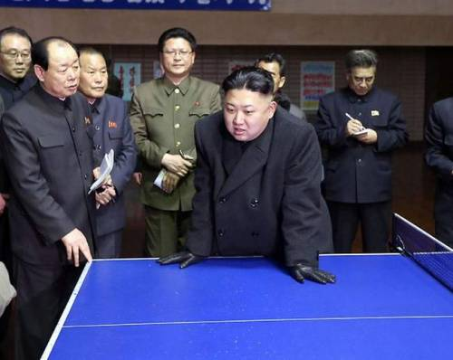 kim jung un looking at over a ping pong table