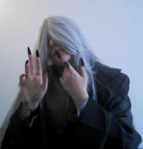 xkyuketsuki:  My Undertaker clothes came in today. Keep in mind though that the wig is not styled, I have no makeup on and it was taken with my horrible webcam. When I get the things I need it will be even better. I also intend to do some gifs when I can get PS to do as it is told so you all can see the costume better thus far.  So keep a look out for that.  (Is this guy not the coolest? :D )