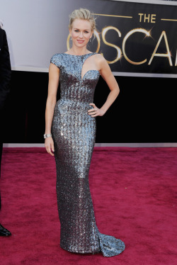 Naomi Watts #Oscars2013 ericcampbell:  I really loved this. SHINY! Naomi Watts knows how to look beautiful. I loved the shimmer of the dress, and I love the cutoff sleeve. Her hair and makeup are beautiful and I think this was spot on. It's such an interesting dress that she makes look so beautiful.