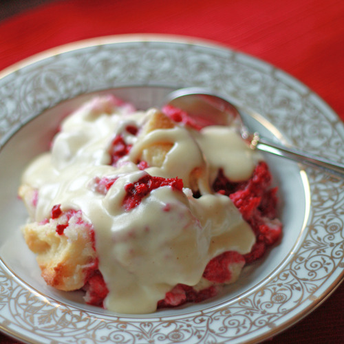gastrogirl:  raspberry bread pudding with vanilla sauce.