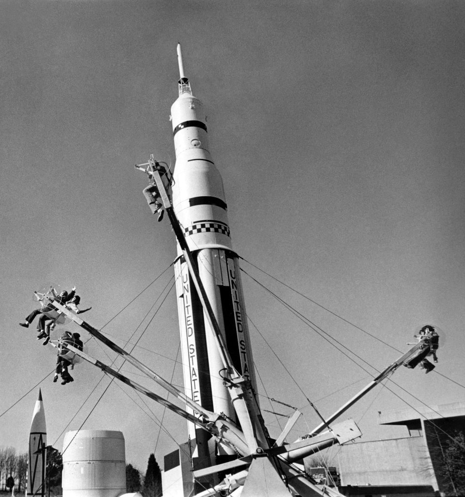 Jan. 16, 1976: At the Alabama Space and Rocket Center in Huntsville, children rode in zero-G, or something like it, with an American rocket on display behind them in this unpublished photo. Photo: Teresa Zabala/The New York Times