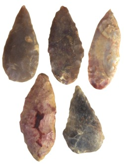 "sadighgallery:  Ancient Egypt. 5 Neolithic flint tips, roughly carved surface in various colors. 3000 BC (1 ¾""- 1 ¼"")"