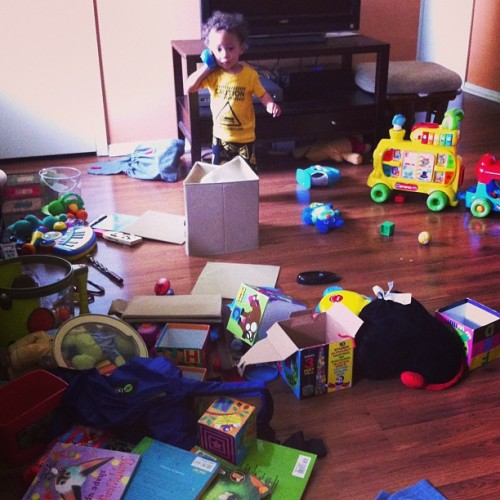 He can't just let the living room be clean. Every toy has to be dumped out to create a wasteland of leapfrog, sing-a-ma-jigs, and books.
