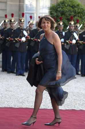 sexigapolitiker:  I love how former French minister Christine Albanel's dress is being lifted by the wind - too bad she wore pantyhose and not stay-up stockings that day!