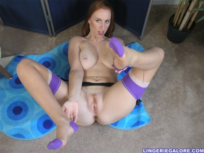 lingeriegalore:  Busty redhead in FF stockings