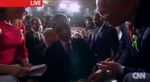 President Obama, departing the Senate chamber following his State Of The Union address, once again in the thick of one of the biggest, and perhaps most deferential autograph-seeking mobs youy'll ever see. What did you guys think?