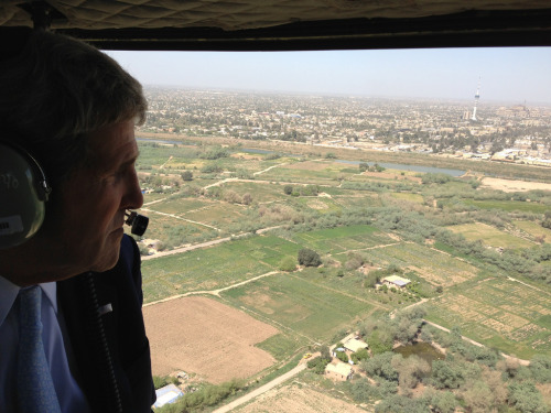 U.S. Secretary of State John Kerry surveys Baghdad as he travels to meetings during an unannounced stop on March 24, 2013. [State Department Photo/Public Domain]