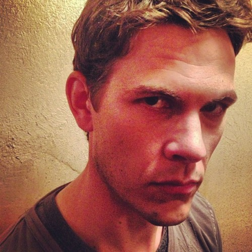 "itsclicheiknow:   ""Uh oh"" - @halfadams (x)  Does that mean Trevor is back, guys? OH MY GOD, YESSS!  What if now that Harvey is angry at Mike, Mike starts falling into all his old bad habits? Like hanging out with this guy? Because Mike doesn't know what to do in a world where Harvey isn't there to support him. And he just feels so alone more than he has in ages, because suddenly everything's wrong. Grammy's gone, Rachel has to hate him after learning the truth about Harvard, Donna — despite her own personal feelings towards him — will always, always be on Harvey's side, and Jessica will never be in his corner so that she can protect her own, Jenny hasn't spoken to him in months, Harvey practically hates him, and even sweet, naive Harold is gone. And so in a moment of weakness after what felt like the longest day at the office ever, of being constantly ignored by everyone with case upon case piled on top of his desk until he couldn't take it anymore and he found himself biking in the other direction instead of heading home until he was standing on Trevor's front step with his hand still raised. And maybe Trevor isn't one hundred percent happy to see him, but he's already too high to really care and invites Mike inside and it's all that he's wanted and missed for so long. So he takes a drag of the joint and pretends not to think of the last time he did this with Harvey and leans his head back onto the familiar curve of Trevor's couch and asks if there's any leftover pizza in the fridge. He knows this is a bad idea — a terrible one — but mike just needs to not think for a moment and Trevor has always been able to give him that."