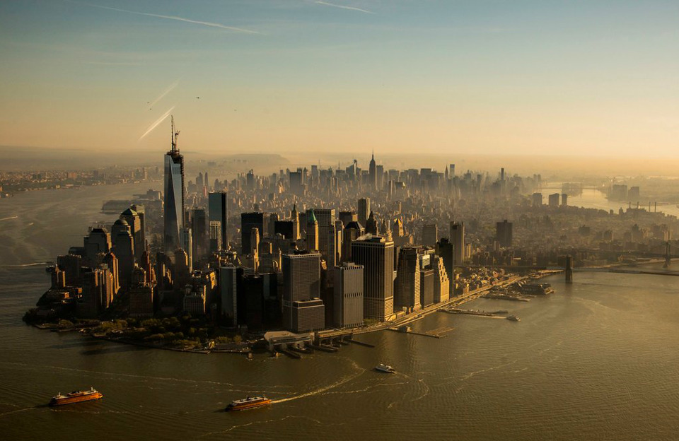 The New York Times' Pictures of the Day includes this beautiful image of Manhattan as the construction of One World Trade Center reached its symbolic height of 1,776 feet.