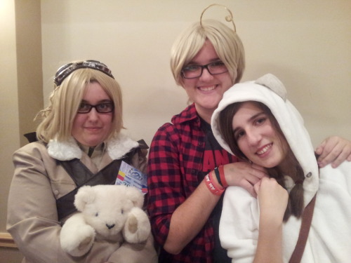 """pickseese:  HEEEEEEEEEEEY SO. I am so incredibly late in posting these… but life and school happened and these pics sort of slipped my mind. oops uvu Anyways, here are my favourite pics from N2U back in October/early November. I spent the whole day as a casual Canada from Hetalia (plaid shirt + CANADA t-shirt). I was also baptized """"good guy Timbits Canada"""" because I spend the first hour handing out Timmies to the artists and vendors :) I also managed to convince my little sister to cosplay for the first time, so she came as my Kuma uvu Also my blue-haired bestie managed to come for the day :D AND I WAS REUNITED WITH MY RUSSIA FROM LAST YEAR/2P! ME. You guys can go check her out here, she's the best. The 2P America and her 2P Iggy (not here, unfortunately D:) are two friends I'm so glad I got to meet, I love you guys <3 That weekend was one of the best of the year, and I can't wait to see you all next year! Except the 2Ps. That is an imminent gathering. SOON."""