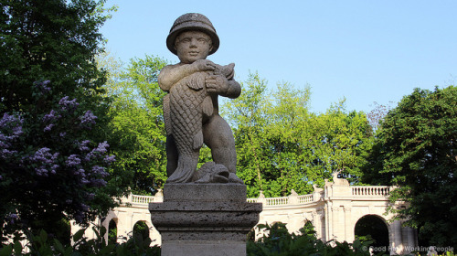 "Boy and fish statue - at the entrance to Märchenbrunnen (Fountain of Fairy Tales) - Volkspark Friedrichshain on Flickr.Via Flickr: Still photo from the video ""Volkspark Friedrichshain (People's Park) – In A Berlin Minute (Week 159)"" Watch the video: movingpostcard.com/volkspark-friedrichshain-berlin/"