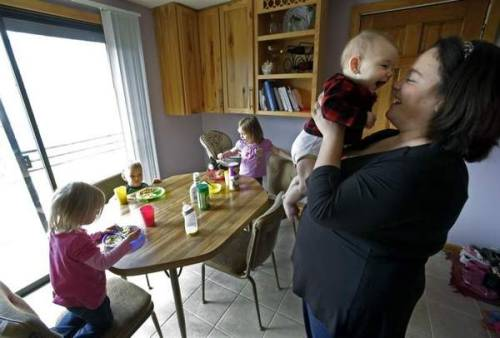 "Childcare costs have nearly doubled in the last 25 years. Families are struggling to keep up.  Combined Locks mother Melanie Bloy Lee expects to spend $16,000 this year for her two children. Jennifer Chan is looking at about $1,700 a month for her two children. ""Our son, Max, will start kindergarten in the fall, and it will probably seem as if we won the lottery,"" Chan said.  (Photo credit: Dan Powers/Post-Crescent Media)"