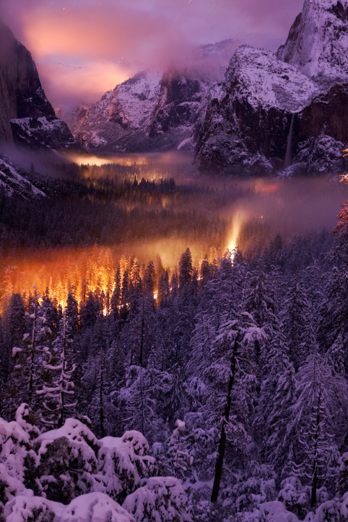 "treeporn:  ""Yosemite Valley at Night - The mist on the valley floor reflects car lights driving through. Yosemite National Park, USA."" (By Phil Hawkins via National Geographic Traveler Magazine: 2013 Photo Contest - The Big Picture)  It's not fire…..it's light. Or. A dragon."