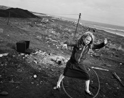 steroge:  Helen and Hula-Hoop, Seacoal Beach, Lynemouth, Tyneside, UK 1984 by Chris Killip