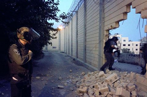 anarcho-queer:  Palestinian Activists Demolish Part of Israeli Apartheid Wall Near Ramallah On Friday 17th May, a group of young Palestinians and activists from the popular resistance movements demolished part of the Israeli apartheid wall in Abu Deis village near Ramallah. One of the activists told PNN that dozens of Palestinians protested near the Israeli apartheid wall that was constructed between the Abu Deis and Al-Eizariya villages and that a number of youngsters demolished part of the wall. He said that Israeli forces arrived to the area and started firing metal-coated bullets and tear gas canisters toward the protesters. Several Palestinians were arrested while others were able to enter into Jerusalem while holding Palestinian flags, he added. A 17-year-old Palestinian was injured with a rubber bullet in his head during clashes erupted in Abu Deis village. Eyewitness said that the injured boy was transferred to Al-Maqased Hospital in the same village for treatment. His injuries were described as serious and severe after being shot by the IOF, according to medical sources.