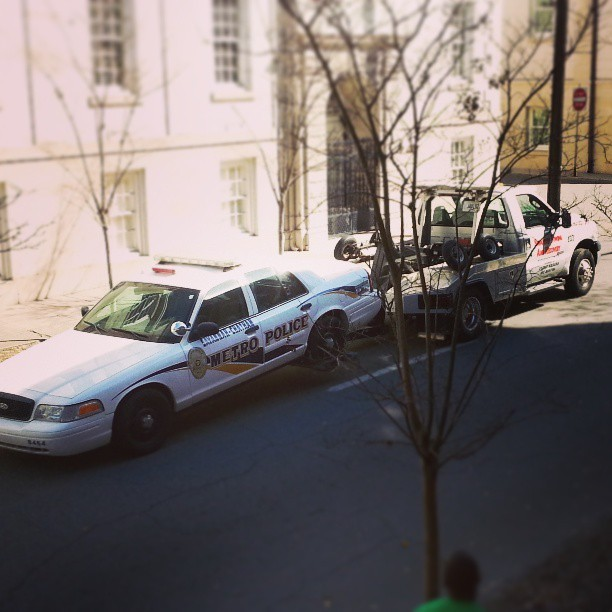 Only st. Patrick's. Police car being towed. Savannah in Whitaker. #gnakabi. #policecarbeingtowed #savannah #Whitaker #findparking